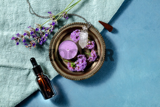 Aromatherapy banner design with copy space. Incense cone, essential oil, scented candle, perfume vial, vervain and lavender, shot from the top with a place for text