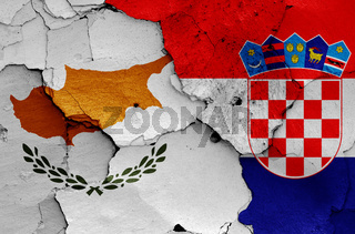 flags of Cyprus and Croatia painted on cracked wall