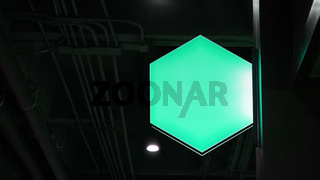 Blank hexagon lightbox signage hang on wall