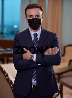 business man wearing protective face mask at office