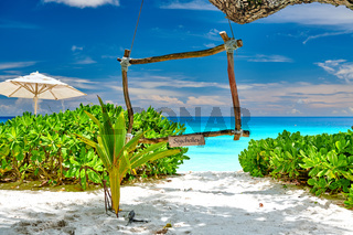 Beautiful Petite Anse beach with wooden frame at Seychelles