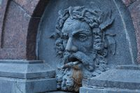 fountain with stone human head