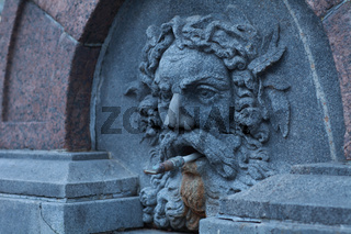 fountain with stone human head