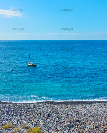 Small sail boat in the Atlantic Ocean off the Tenerife coast,