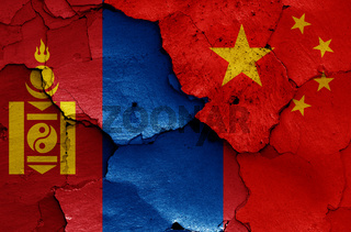 flags of Mongolia and China painted on cracked wall