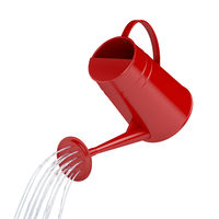 Pouring water from a red watering can