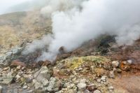 Breathtaking view of volcanic landscape, hot spring, eruption fumarole in crater of active volcano