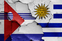 flags of Artigas Department and Uruguay painted on cracked wall