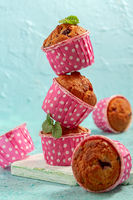 Muffins with currant in pink forms.