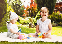 Happy kids playing in summer garden