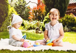 Happy kids playing in summer garden