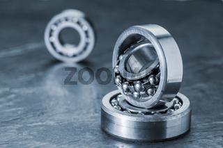 Three spherical roller bearings on slate