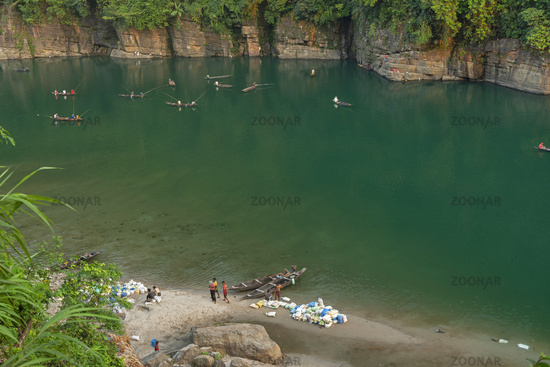 MEGHALAYA, INDIA, October 2015, People doing fishing with their boats at Umngot river