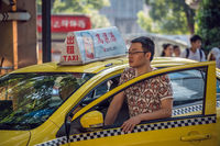 Taxi driver waiting for a passenger in Chongqing