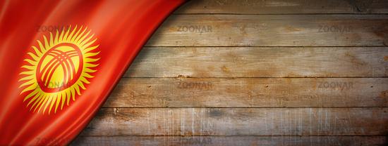 Kyrgyzstan flag on vintage wood wall banner