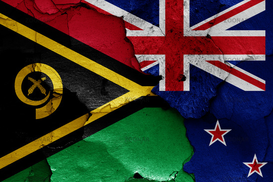 flags of Vanuatu and New Zealand painted on cracked wall