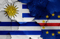 flags of Uruguay and Cape Verde painted on cracked wall