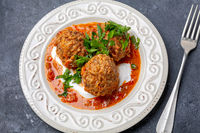 Meatballs with tomato sauce and parsley.