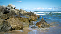 Boulders as breakwaters on the beach of Niechorze on the Polish Baltic Sea coast