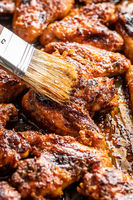 Grilled chicken wings in barbecue sauce