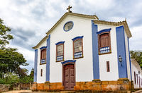 Small and old church and crucifix in colonial architecture at Tiradentes city