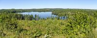 panoramic view across the lake Gissen and the surrounding forests in  the region Kalmar, Sweden