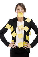 Business woman with yellow paper notes