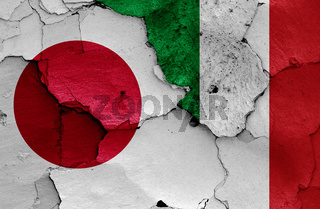 flags of Japan and Italy painted on cracked wall