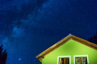 Green house under dark blue night sky