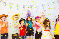 Kid's Birthday party with party horns and confetti