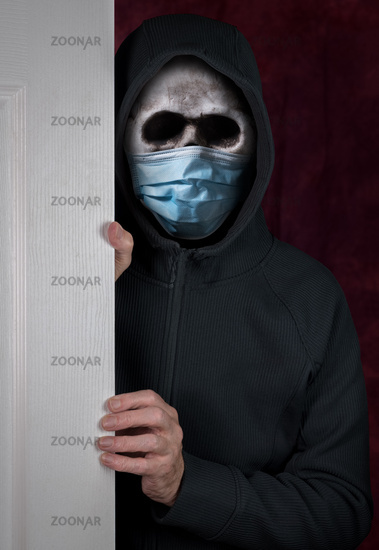 Halloween theme of stalker with skull and face mask against coronavirus entering a home