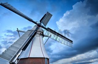 Dutch windmill over blue sky