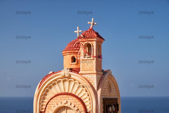 Small roadside chapel (Proskinitari) on the Petra tou Romiou Viewpoint. Limassol. Cyprus