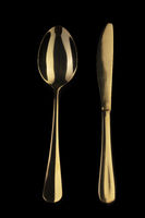 Gold knife and spoon on a black background. Cutlery.