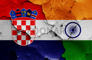 flags of Croatia and India painted on cracked wall