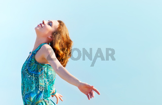 Portrait of the beautiful young woman with fluttering red hair