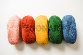 Collection of threads of rainbow color on the white background