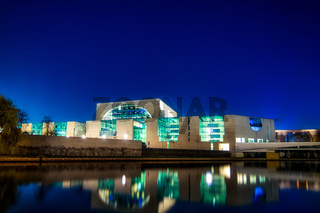 the illuminated chancellors office seen from the river Spree