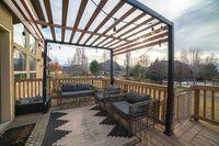 Wooden pergola over an exterior patio day light