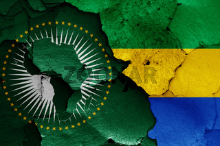flags of African Union and Gabon painted on cracked wall