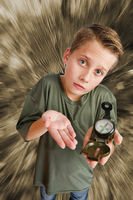 Boy hold a compass on monochrome background