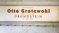 sign commemorating cornerstone ceremony by otto grotewohl at housing complex at karl-marx-allee
