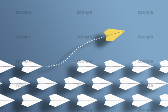 paper planes in a row on blue background and one paper glider going in different direction