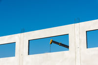 A crane behind a window of the modular building