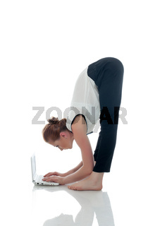 Image of flexible businesswoman working on laptop