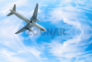 Jet airplane landing in blue sky