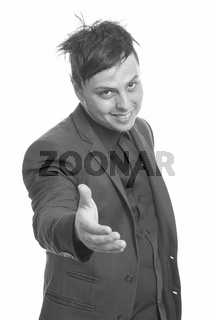 Studio shot of crazy Caucasian businessman giving handshake