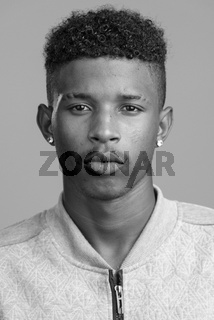 Face of young handsome African man in black and white