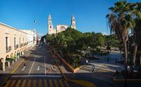 View to the cathedral of Merida over the main square park 'Plaza Grande' in Merida, Yucatan, Mexico