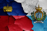 flags of Liechtenstein and San Marino painted on cracked wall